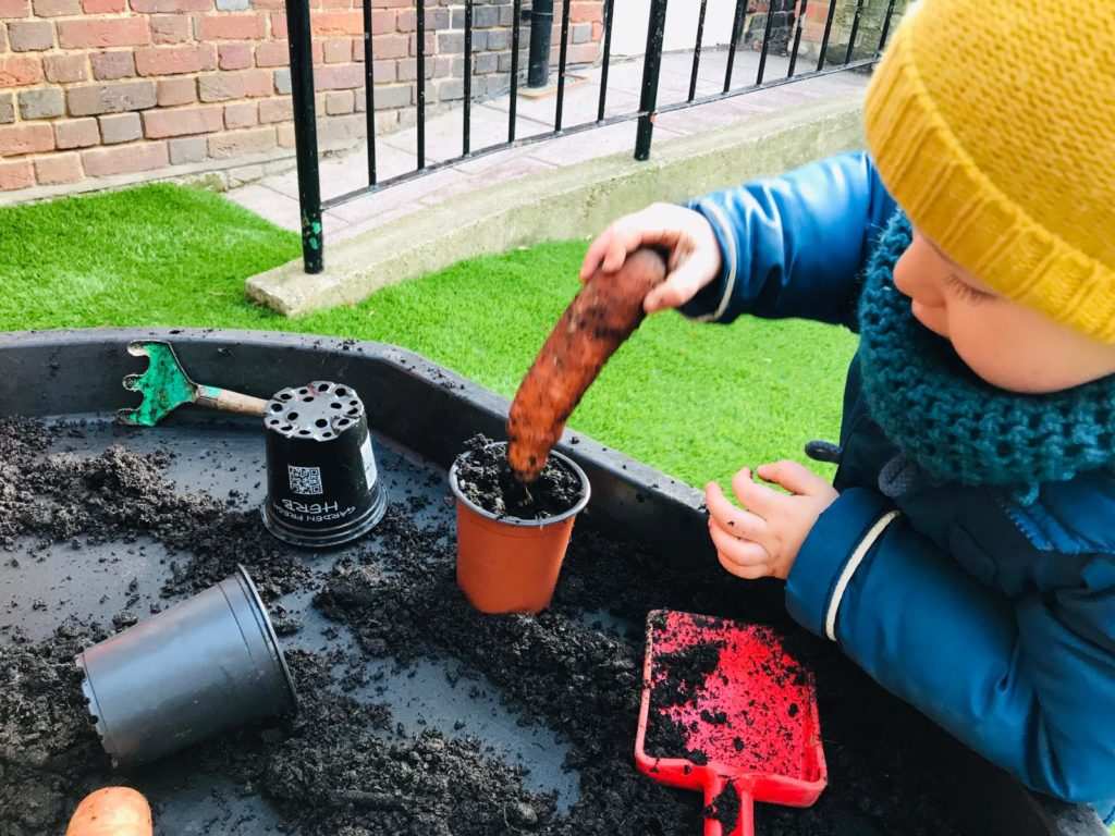 kid-playing-nursery-gardening