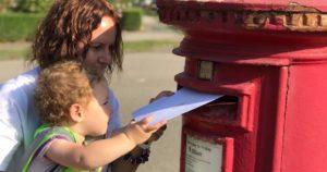 children-posting-letter