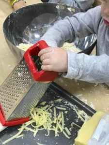 children-playing-cheese-grating